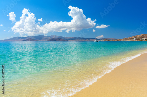 фотография beautiful sandy beach on Naxos island, Cyclades, Greece