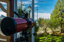 Red Telescope Inside A House P...