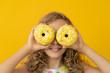 Leinwanddruck Bild - Happy child holding glazed donut