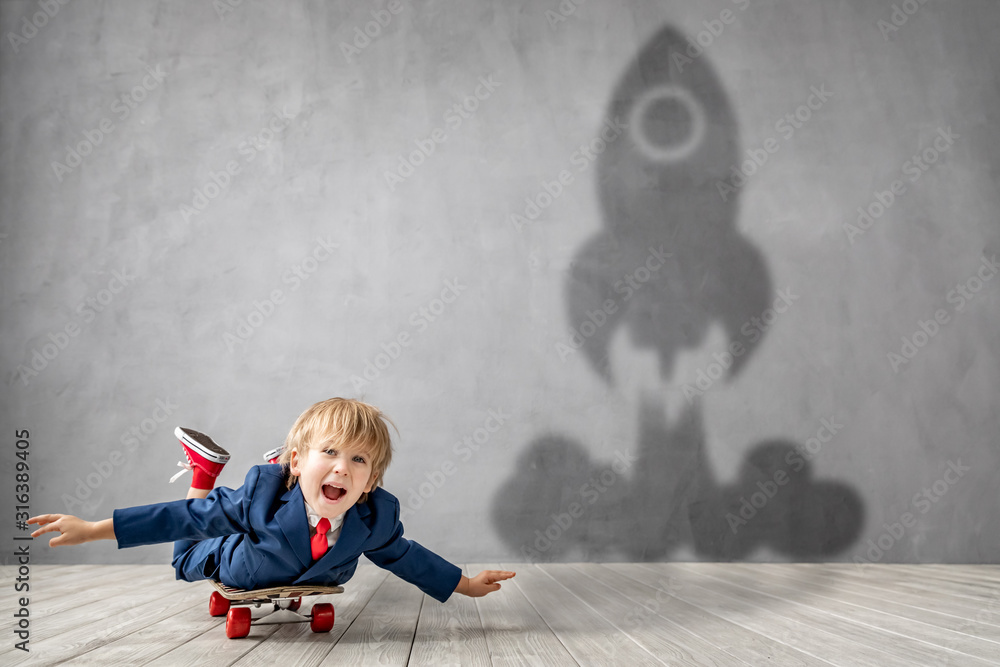 Fototapeta Happy child wants to fly. Imagination, freedom and motivation concept