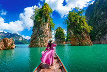 Asian Woman Posing On Boat In Ratchaprapha Dam Khao Sok National Park At Suratthani,Thailand..