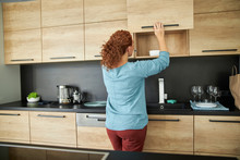 Curly Woman In Modern Kitchen ...