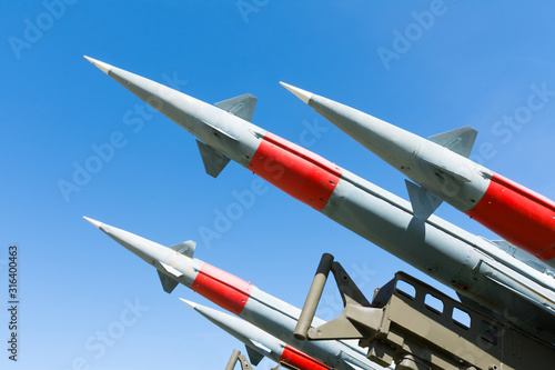 rocket of antiaircraft defense on a background of blue sky Wallpaper Mural