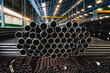 Leinwandbild Motiv high quality Galvanized steel pipe or Aluminum and chrome stainless pipes in stack waiting for shipment  in warehouse