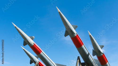 rocket of antiaircraft defense on a background of blue sky Canvas Print