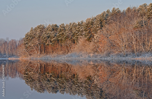 Winter landscape of the frosted shoreline of Crooked Lake at sunrise with mirror Canvas Print