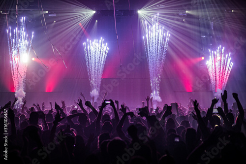 Party crowd at an indoor event with fireworks - 316406467