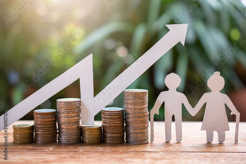 Fototapeta old couple model standing with money coins saving for concept investment mutual fund finance and pension retirement obraz