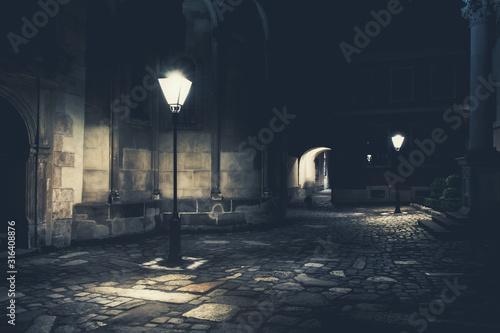 Fotomural illuminated street at night. Old european city