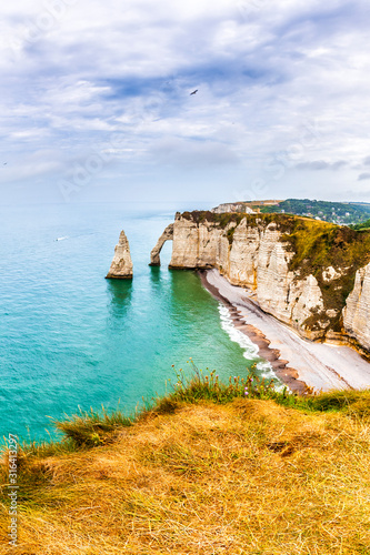 Panorama of natural chalk cliffs of Etretat with visible arche and beach coastli фототапет