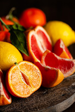 Slices Of Ripe Fresh Organic Citrus Fruits: Grapefruit, Orange, Lemon On Wooden Board. Natural Source Of Vitamins, Low Calories Tasty Dessert. Dark Background, Close Up, Front View