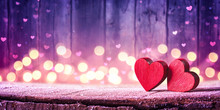 Two Red Hearts On Rustic Table With Soft Lights On Wooden Background - Valentine's Day Concept
