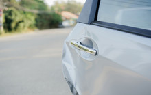 Close Up Front View Of Opening Vehicle Door With Dented After Facing Problems From Traffic Jam For Car Insurance Claim  Concept