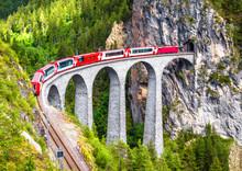 Landwasser Viaduct In Filisur, Switzerland. It Is Landmark Of Swiss Alps. Bernina Express Train On Railroad Bridge In Mountains. Aerial Scenic View Of Famous Railway.