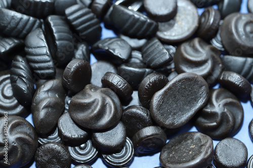 Black licorice candys as backgound.
