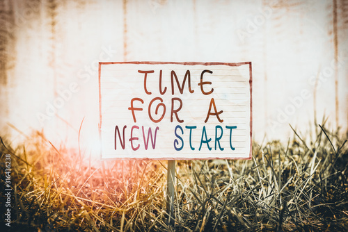 Text sign showing Time For A New Start Wallpaper Mural