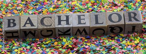 Photo Bachelor written on wooden blocks isolated on confetti background