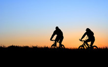 Mountain Bikers In Silhouette ...