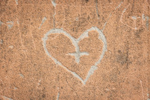 Grainy Cement Wall Background With A Shape Of A Heart And A Cross