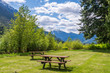 Picnic Table in Park with mountain background.