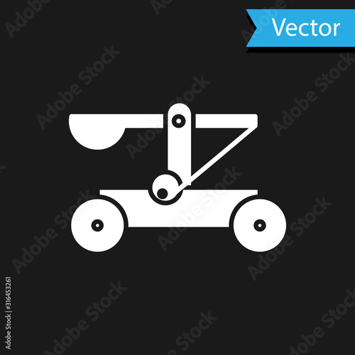 Fotografia White Old medieval wooden catapult shooting stones icon isolated on black background