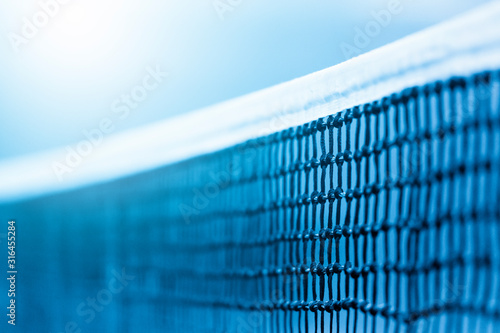 Fototapeta Tennis net and blue court. Individual sport. Blue filter obraz