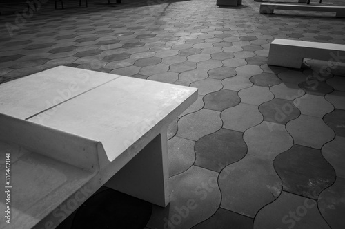 Simple urban architecture elements and tiled floor in a park, in black and white.