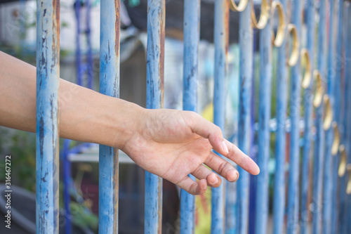 hand in jail Tablou Canvas