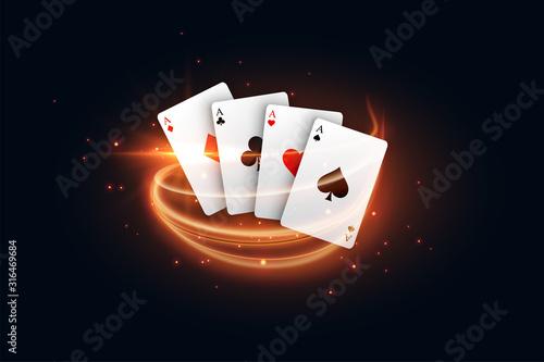 Fotografia casino playing card with golden light streak