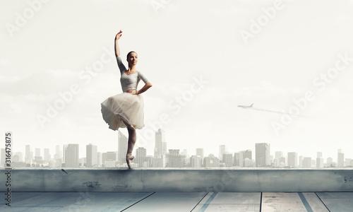 Obraz na plátně Elegant ballerina dancing. Mixed media