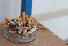 Cigarette Buds Accumulated On Small Ash Tray