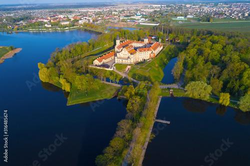 Spring landscape with the old Nesvizh castle. Belarus Wallpaper Mural