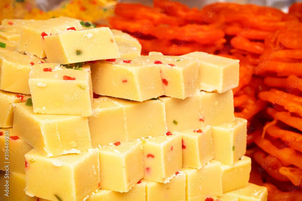Fototapeta Burfi Indian sweets sold on street stalls