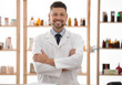 Portrait of happy male pharmacist in drugstore