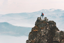 Traveler Man Climbing On Mountain Top Adventure Travel Extreme Healthy Lifestyle Vacations Hiking Outdoor Success Achievement Brave Hiker On The Edge