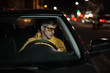 Man driving car in special yellow eyeglasses at night for good night vision