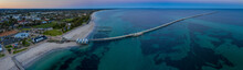 Panoramic Aerial Dawn View Of The Iconic Busselton Jetty And The Town In The Backgreound, Which Is Located 220 Km South West Of Perth, Western Australia