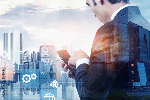 Cuadros en Lienzo Man using smartphone in city, business interface