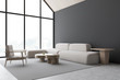 Gray attic living room corner with armchair