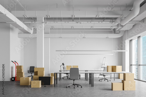 Boxes in open space office, moving concept Canvas Print
