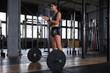 Leinwanddruck Bild - Attractive muscular fit woman exercising building muscles.