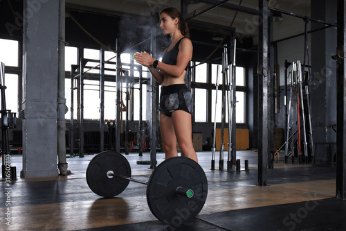 Fototapeta Attractive muscular fit woman exercising building muscles. obraz