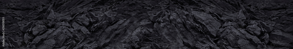Black mountain texture closeup. Long grunge banner. The geometric shape of the stone 3d effect. Black abstract grunge background.