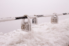 Icy Love Locks On A Barrier On...
