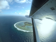 Flying Over A Small Tropical I...