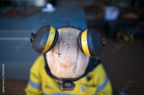 Photo Top view of pictures of ears muffs protection attached clipping into rope access