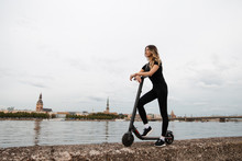 Fit Woman By Electric Scooter ...