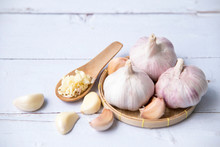 Garlic, Sliced Garlic, Garlic Bulbs With Garlic Cloves In  Basket Place  On White Color Vintage Wooden  Background.