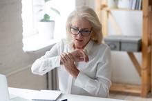 Mature Businesswoman Touching Hand Feeling Wrist Pain