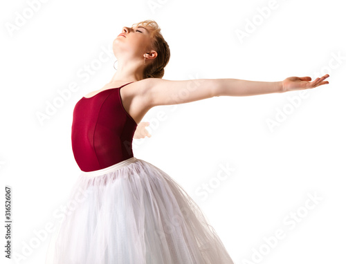 Obraz na plátně Young beautiful ballerina in white tutu and pointe shoes doing dancing pose